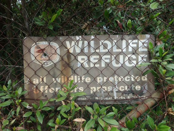 old sign of wildlife refuge